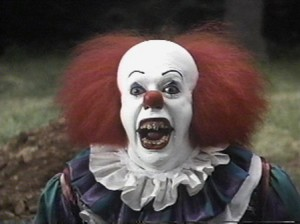Tim Curry as scary clown Pennywise in IT!